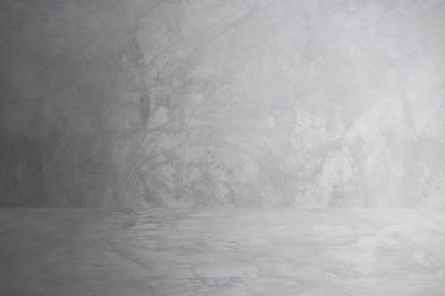 Grauer zementwandstudio und leerer bodenhintergrund für anwesendes produkt