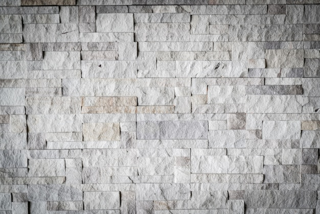 Graues backsteinmauerdetail und -beschaffenheit