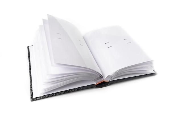 Graues fotoalbum lokalisiert auf weißem tisch.