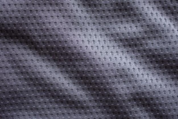 Graues gewebesportkleidungsfußballtrikot mit luftmaschenbeschaffenheitshintergrund