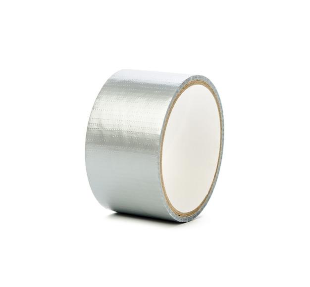 Graues klebeband lokalisiert auf weißem hintergrund, rolle