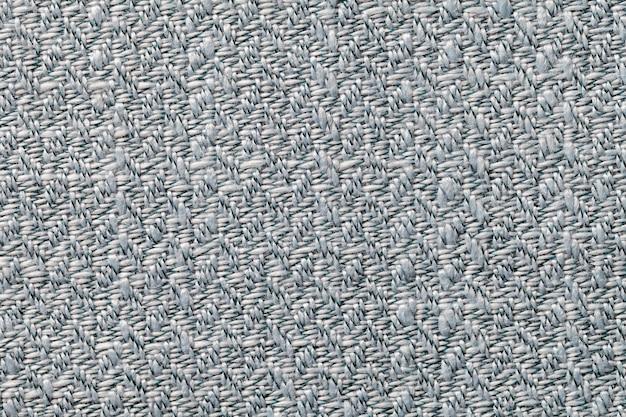 Graues weinlesegewebe mit gesponnener beschaffenheitsnahaufnahme. textilmakrohintergrund