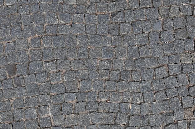 Gray granit kopfsteinpflaster gehweg flatlay