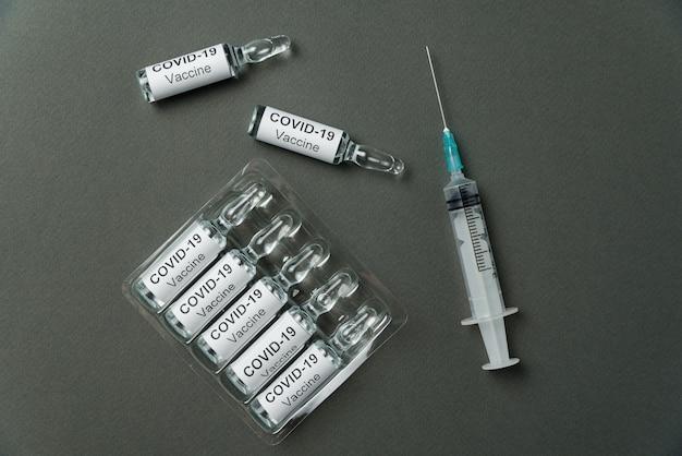 Grippe-coronavirus-impfstoff und spritze. impfstoffinjektion für ncov 2019.