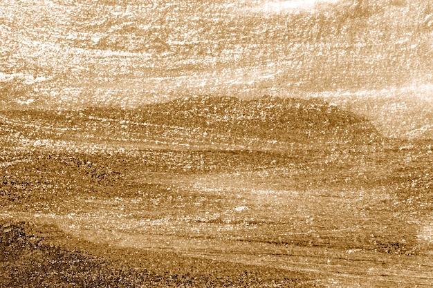 Grob gold lackierter betonwandoberflächenhintergrund