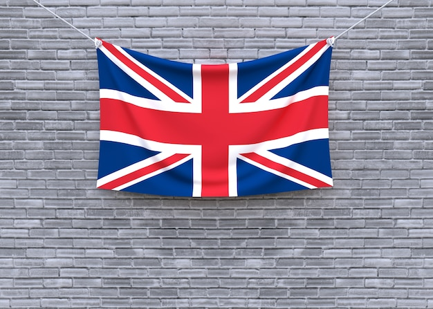 Großbritannien-flagge, die an der backsteinmauer hängt