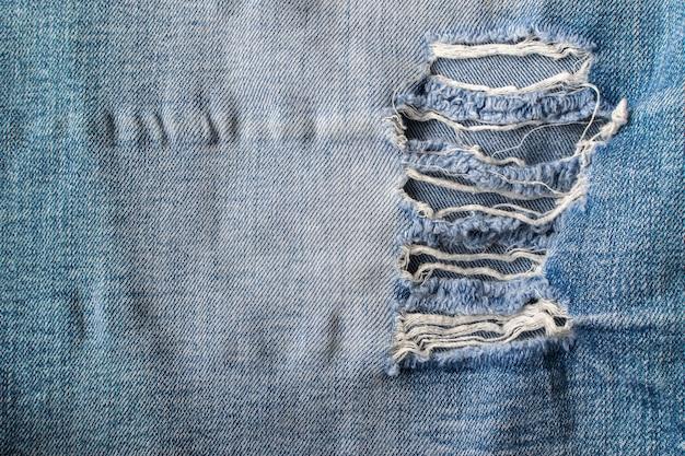 Große löcher auf old torned jeans backgroung