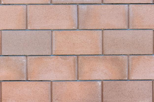 Großer betonziegelwandbeschaffenheitshintergrund, material des industriebaus. Premium Fotos