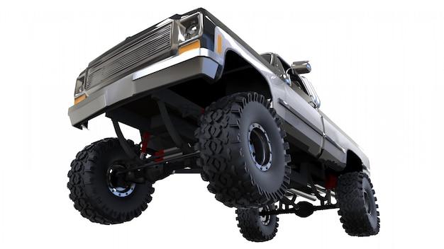 Großer pickup im gelände. volles training. hoch angehobene federung. riesige räder mit stacheln für felsen und schlamm. 3d-rendering.