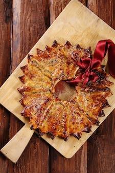 Großer weihnachtsstern, ein traditionelles dessert. ukrainische kalita