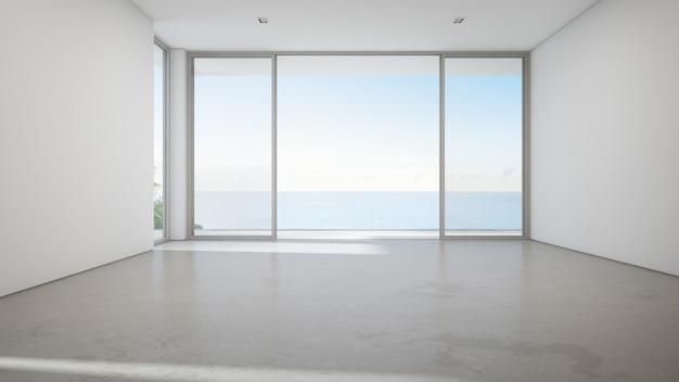 Großes wohnzimmer der seeansicht des luxussommerstrandhauses mit großer glastür und leerem konkretem boden.