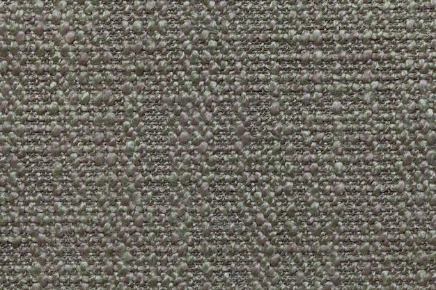 Grün gestrickte wolle mit einem muster aus weichem, flauschigem stoff. beschaffenheit der textilnahaufnahme.