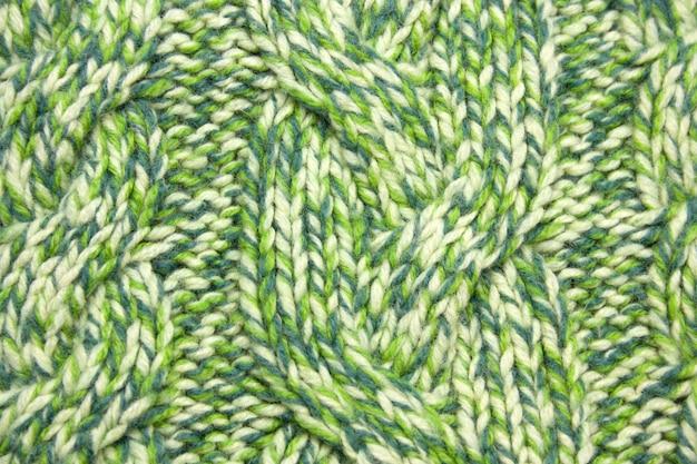 Grün gestrickte woolen strickjackebeschaffenheit