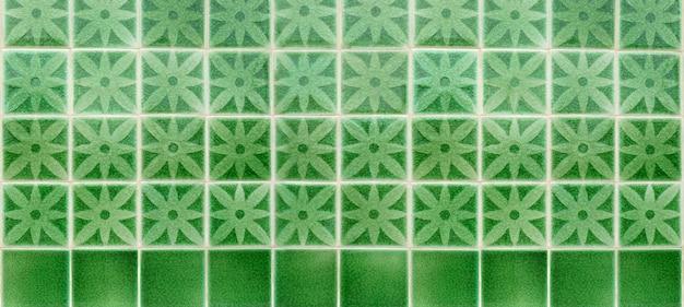 Grün glasierter fliesenmosaikhintergrund