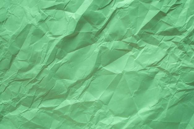 Grün zerknitterter papierabschluß herauf beschaffenheitshintergrund