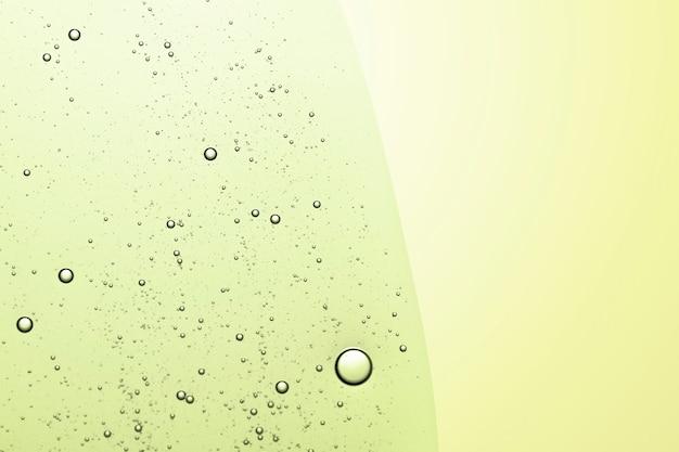 Grüne abstrakte hintergrundölblase in wassertapete