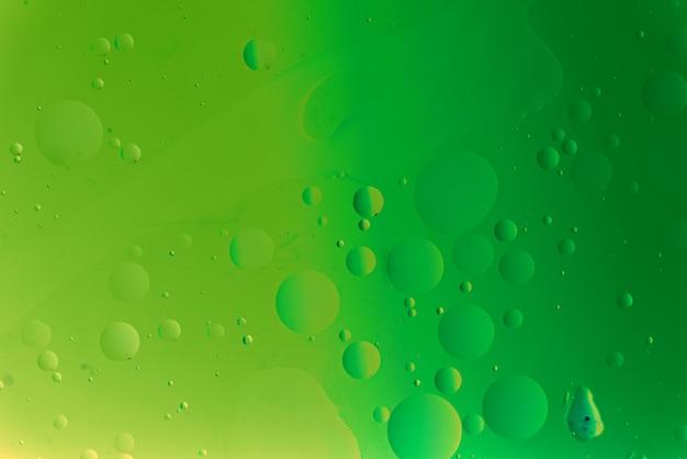 Grüne abstrakte textur mit einschlüssen, kunsthintergrundkonzept