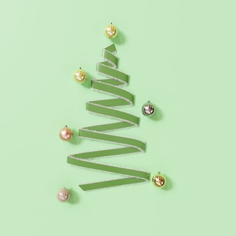 Grüne band-weihnachtstagdekorationsgegenstände formen durch weihnachtsbaum auf grün. minimale idee. 3d-rendering.