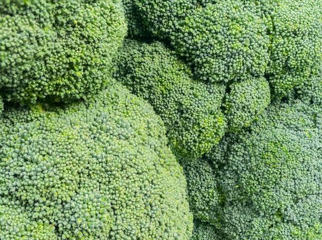 Grüne brokkolikopf backgraund fotomakrobeschaffenheit