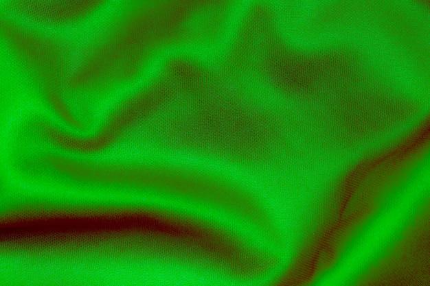Grüne farbe sportbekleidung stoff fußballtrikot jersey textur und textilhintergrund.