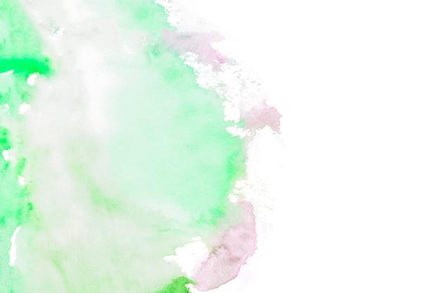 Grüne farbenanschläge auf weißem hintergrund
