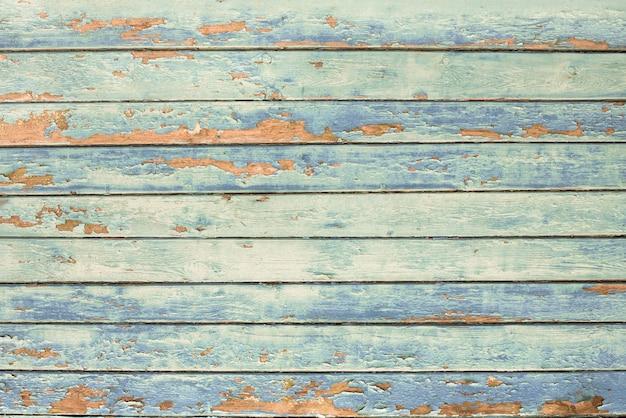 Grüne flut, blaue, orange alte holzbeschaffenheitshintergründe. horizontale streifen, bretter. rauheit und risse.
