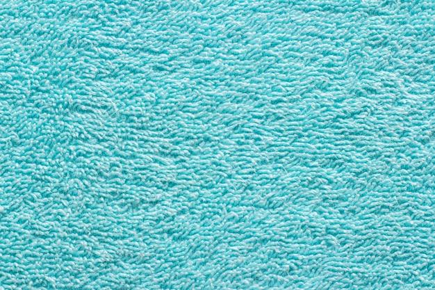 Grüne handtuchbeschaffenheit der nahaufnahme für hintergrund. frottiertuch. erhöhte textur