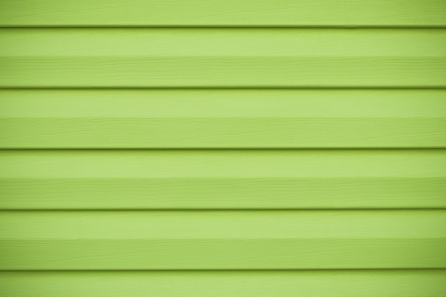 Grüne holzstruktur in horizontalen streifen. brett der kalkfarbe, gelbe wand in den linien.