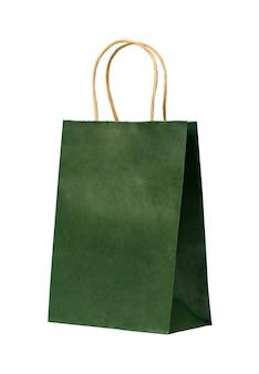 Grüne papiertüte mit den griffen lokalisiert. kopieren sie platz