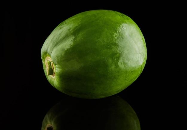 Grüne runde papaya