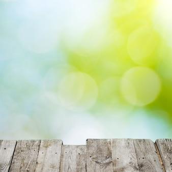 Grüne und gelbe lichtpunkte können als hintergrund verwendet werden
