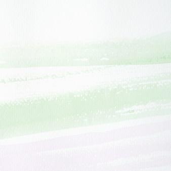 Grüne und purpurrote abstrakte aquarellmalerei gemasert auf weißbuchhintergrund