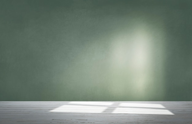 Grüne wand in einem leeren raum mit betonboden