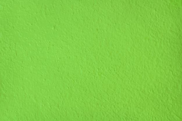 Grüne zementwandbeschaffenheit für hintergrund und designkunstarbeit.