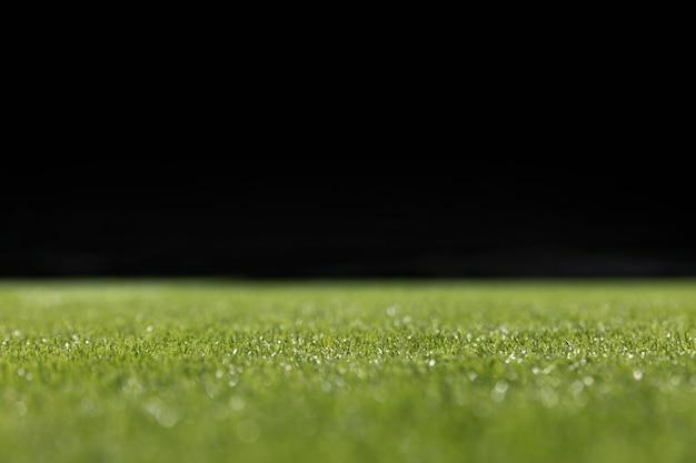 Grüner fußballplatz der nahaufnahme