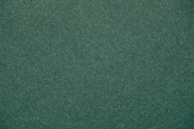 Grüner glitter strukturierter papierhintergrund