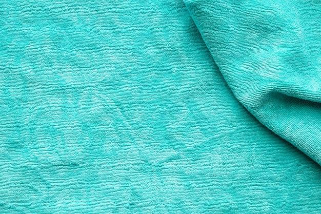 Grüner handtuchstoff texturoberfläche schließen hintergrund