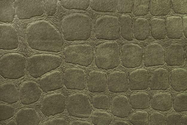 Grüner hintergrund vom weichen polsterungstextilmaterial, nahaufnahme. stoff mit muster