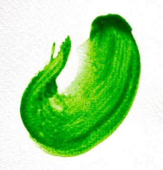 Grüner pinselstrich auf weißbuch
