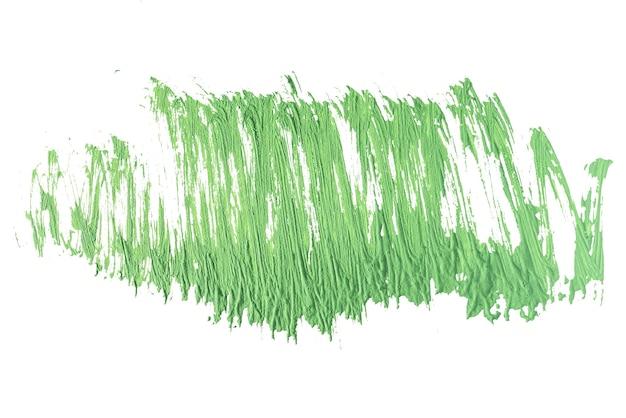 Grüner pinselstrich auf weißem papier