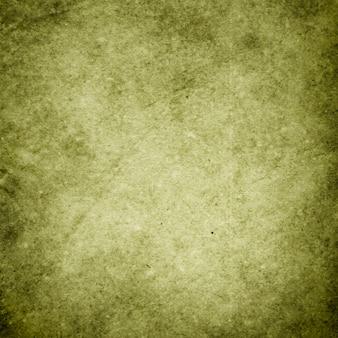 Grüner schmutzhintergrund, beschaffenheit des rauen alten papiers in den flecken und in den streifen