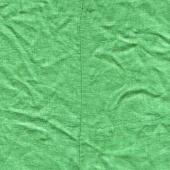 Grüner segeltuchbeschaffenheitshintergrund