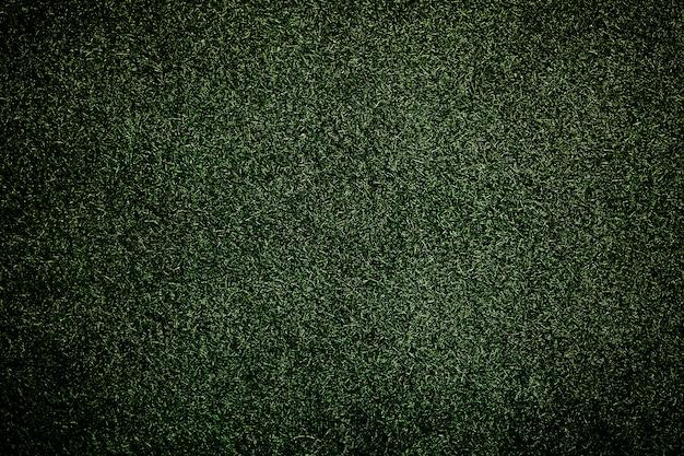 Grüner strukturierter hintergrund aus plastikgras