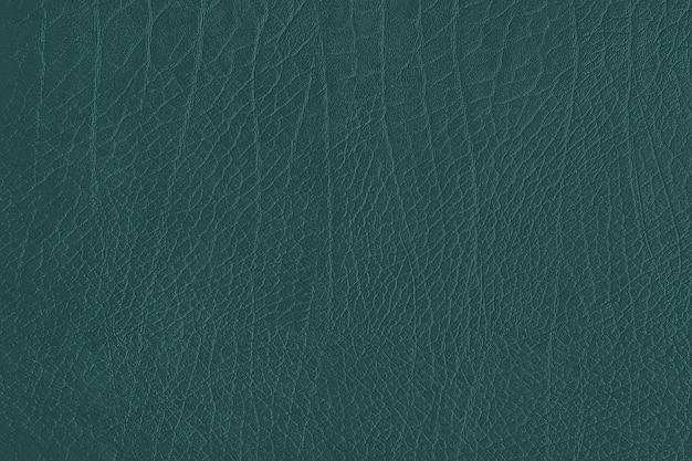 Grüner strukturierter hintergrund aus zerknittertem leder
