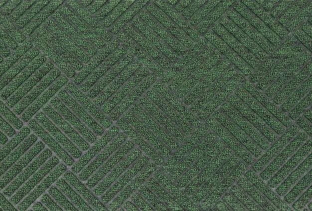 Grüner strukturierter türteppich