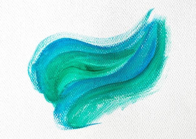 Grüner und blauer farbfleck auf leinwand