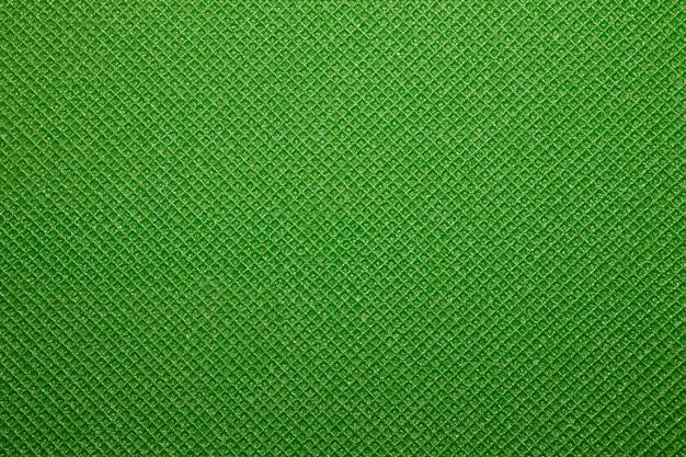 Grüner yogamattenbeschaffenheitshintergrund. hintergrund der campingmatte