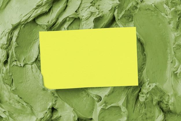 Grüner zuckerguss textur hintergrund mit visitenkarte