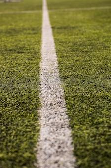 Grünes gras des fußballfeldes