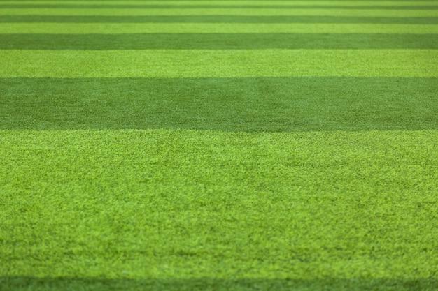Grünes gras-hintergrund-rasen-gras-oberflächenzusammenfassung. kunstrasen-fußballplatz